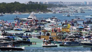 "Boaters crowd an area known as ""Crab Island"" in the shallow waters near Destin Fla., Saturday, May 23, 2020, as the long Memorial Day weekend begins during the coronavirus pandemic. (Michael Snyder/Northwest Florida Daily News via AP)"