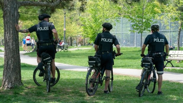 Bicycle police officers keep an eye on Trinity Bellwoods Park in Toronto on Sunday, May 24, 2020. THE CANADIAN PRESS/Frank Gunn