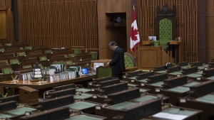 A House of Commons clerk prepares for the COVID-19 committee to meet in the House of Commons Chamber Wednesday April 29, 2020 in Ottawa. Intense behind-the-scenes negotiations are to continue today among federal political parties over how Parliament should function as the COVID-19 crisis drags on. The House of Commons, which has been largely adjourned since mid-March, is to resume normal operations on Monday. THE CANADIAN PRESS/Adrian Wyld