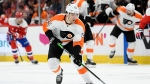"FILE - In this March 4, 2020, file photo, Philadelphia Flyers left wing James van Riemsdyk (25) skates with the puck during the first period of an NHL hockey game against the Washington Capitals in Washington. NHL players are debating the merits of quarantining away from family members as part of a potential resumption of the season. ""For sure that's a big thing,"" said van Riemsdyk, one of the players on the Return to Play committee and a new father. ""No one wants to be away from their family for months on end, and everyone is aware of that with who's on this committee."" (AP Photo/Nick Wass, File)"
