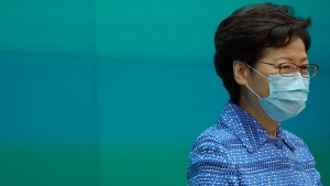 Hong Kong Chief Executive Carrie Lam listens to reporters' questions during a press conference held in Hong Kong, Tuesday, May 26, 2020. Lam tried again Tuesday to defend a new national security law that China's parliament is going to impose on Hong Kong. (AP Photo/Vincent Yu)