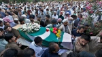 People attend funeral prayers of victims of Friday's plane crash, in Rawalpindi, Pakistan, Monday, May 25, 2020. A passenger plane belonging to state-run Pakistan International Airlines carrying passengers and crew crashed Friday near the southern port city of Karachi. (AP Photo/Anjum Naveed)