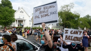 Hundreds of protesters gather Tuesday, May 26, 2020 near the site of the arrest of George Floyd who died in police custody Monday night in Minneapolis after video shared online by a bystander showed a white officer kneeling on his neck during his arrest as he pleaded that he couldn't breathe. (AP Photo/Jim Mone)