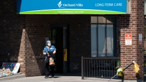 A home-care worker is shown outside Orchard Villa long-term care home in Pickering, Ont., on Tuesday, May 26, 2020. THE CANADIAN PRESS/Frank Gunn