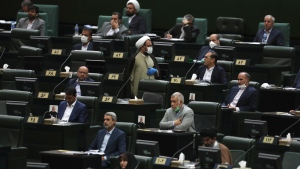 Lawmakers listen to a speech during the inauguration ceremony of Iran's new parliament, in Tehran, Iran, Wednesday, May, 27, 2020. Iran convened its newly elected parliament, dominated by conservative lawmakers and under strict social distancing regulations, as the country struggles to curb the spread of coronavirus that has hit the nation hard. Iran is grappling with one of the deadliest outbreaks in the Middle East. (AP Photo/Vahid Salemi)