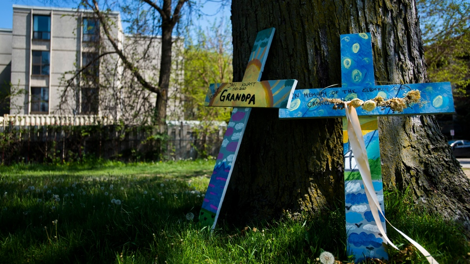 Crosses are displayed outside the Camilla Care Community centre marking the deaths of multiple people that occurred during the COVID-19 pandemic in Mississauga, Ont., on Tuesday, May 26, 2020. (THE CANADIAN PRESS/Nathan Denette)