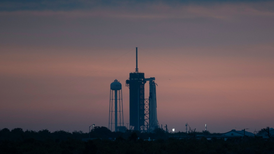 A SpaceX Falcon 9 rocket is seen on the launch pad, Wednesday, May 27, 2020, at Kennedy Space Center in Florida. SpaceX plans to launch two NASA astronauts to the International Space Station. This will be the first astronaut launch from Florida in nearly a decade, and a first for a private company. (Joel Kowsky/NASA via AP)