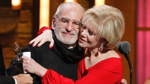 "This June 12, 2011 file photo shows Larry Kramer, left, and Daryl Roth embracing after they won the Tony Award for Best Revival of a Play for ""The Normal Heart"" during the 65th annual Tony Awards in New York. (AP Photo/Jeff Christensen, File)"