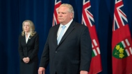 Ontario Premier Doug Ford, visibly upset, listens to questions about a disturbing report from the Canadian military regarding five Ontario long-term-care homes during his daily updates regarding COVID-19 at Queen's Park in Toronto on Tuesday, May 26, 2020. THE CANADIAN PRESS/Nathan Denette