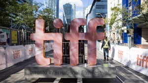 A sign bearing the Toronto International Film Festival logo is carried on a fork lift down street in downtown Toronto as preparations are made for the festival's opening night on September 7, 2017. THE CANADIAN PRESS/Chris Young