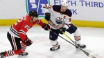 FILE - In this March 5, 2020, file photo, Edmonton Oilers center Connor McDavid, right, and Chicago Blackhawks center Ryan Carpenter vie for the puck during the first period of an NHL hockey game in Chicago. McDavid gets just his second taste of the playoffs in his fifth season. (AP Photo/Nam Y. Huh, File)