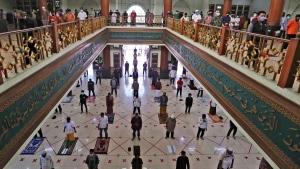 Muslims pray spaced apart to curb the spread of the coronavirus during a Friday prayer at the Al Barkah Grand Mosque in Bekasi on the outskirts of Jakarta, Indonesia, Friday, May 29, 2020. Muslims in some parts of Indonesia attended Friday prayers as mosques closed by the coronavirus for weeks were allowed to start reopening in the world's most populous Muslim nation. (AP Photo/Achmad Ibrahim)