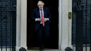 "Britain's Prime Minister Boris Johnson comes out to applaud on the doorstep of 10 Downing Street, during the weekly ""Clap for our Carers"", in London, Thursday, May 28, 2020. The COVID-19 coronavirus pandemic has prompted a public display of appreciation for care workers. (AP Photo/Kirsty Wigglesworth)"