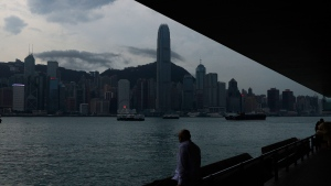 A man sits on the waterfront of the Victoria Harbor of Hong Kong Tuesday, May 26, 2020. Hong Kong has been living on borrowed time ever since the British made it a colony nearly 180 years ago, and all the more so after Beijing took control in 1997, granting it autonomous status. (AP Photo/Kin Cheung)