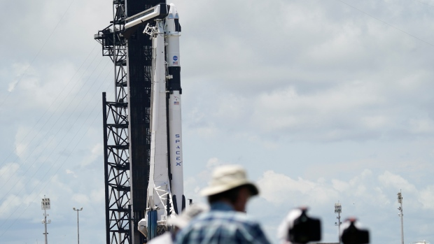 SpaceX`s crewed mission postponed as historic launch hit by bad weather