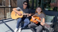 Toronto Blue Jays general manager Ross Atkins and his daughter Rita play guitars in Toronto in a recent handout photo. THE CANADIAN PRESS/HO-Ross Atkins MANADATORY CREDIT