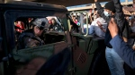 A group of protesters surrounded a National Guard vehicle that were driving on Lake Street towards the blockade under the Hiawatha Light Rail station and forced them to reverse out in Minneapolis, Minn., on Friday, May 29, 2020. A peaceful protests turned increasingly violent in the aftermath the death of George Floyd during an arrest. Mayor Jacob Frey ordered a citywide curfew at 8 p.m. local time, beginning on Friday. (Renee Jones Schneider/Star Tribune via AP)
