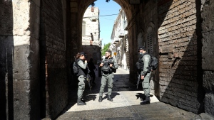 Israeli police officers secure the area of Lion's gate in Jerusalem's Old City, Saturday, May 30, 2020. Israeli police shot dead a Palestinian near Jerusalem's Old City who they had suspected was carrying a weapon but turned out to be unarmed. (AP Photo/Mahmoud Illean)