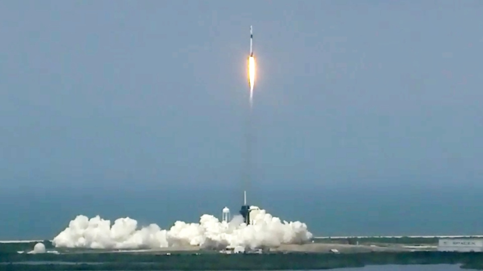 In this image made from video via NASA-TV, a SpaceX Falcon 9, with NASA astronauts Doug Hurley and Bob Behnken in the Dragon crew capsule, lift off from Pad 39-A at the Kennedy Space Center in Cape Canaveral, Fla., Saturday, May 30, 2020. The two astronauts are on the SpaceX test flight to the International Space Station. (NASA via AP)