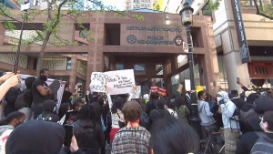 Thousands of people rally in front of Toronto Police Headquarters on Saturday afternoon, demanding for answers in the death of Regis Korchinski-Paquet.