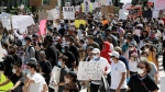 Protesters march during a demonstration, Saturday, May 30, 2020, downtown in Miami. Protests across the country have escalated over the death of George Floyd who died after being restrained by Minneapolis police officers on Memorial Day, May 25. (AP Photo/Wilfredo Lee)