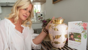 Deborah Ward, whose mother passed away from COVID-19, is seen with the urn holding her mother's ashes at her home in Boucherville, Que., Friday, May 29, 2020. THE CANADIAN PRESS/Ryan Remiorz