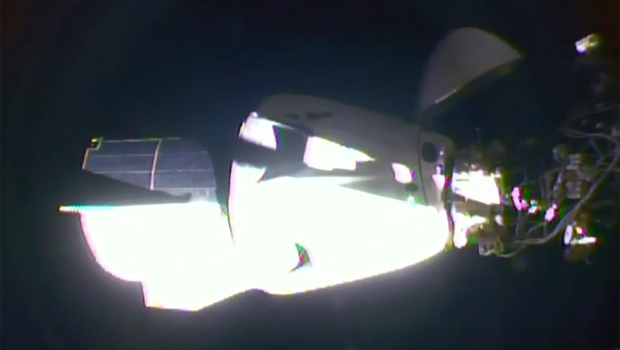 SpaceX's astronaut-riding Dragon arrives at space station