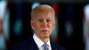 FILE - In this March 10, 2020, file photo, Democratic presidential candidate former Vice President Joe Biden speaks to members of the press at the National Constitution Center in Philadelphia. The police killing of George Floyd and the civil and political unrest that's rocked the nation in the week since has the potential to reshape Joe Biden's vice-presidential selection process. (AP Photo/Matt Rourke, File)