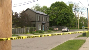 Police are searching for a suspect after two men were shot inside a home in Oshawa on Sunday night.