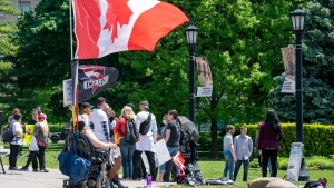Demontrators protest the pace of Covid-19 reopenings outside the Ontario Legislature in Toronto on Tuesday June 2, 2020. THE CANADIAN PRESS/Frank Gunn