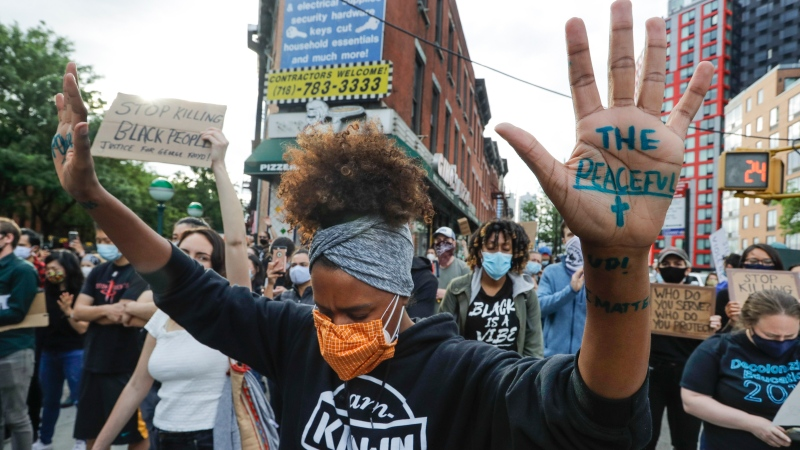 Protesters pray during the Prayerful Protest march for George Floyd, Tuesday, June 2, 2020, in New York. Floyd died after being restrained by Minneapolis police officers May 25. (AP Photo/Frank Franklin II)