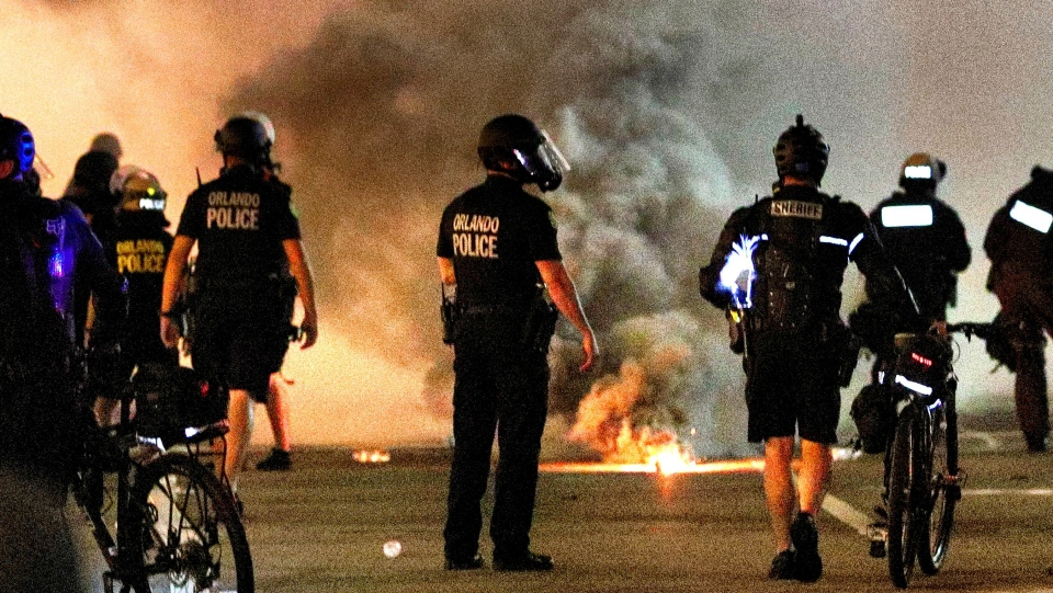 Orlando police deploy tear gas during a demonstration outside Orlando City Hall in downtown Orlando, Fla., Tuesday, June 2, 2020. Large crowds of demonstrators gathered again at locations throughout the city to protest the death of George Floyd in Minneapolis. (Joe Burbank/Orlando Sentinel via AP)