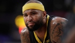 "In this Thursday, April 4, 2019, file photo, then-Golden State Warriors' DeMarcus Cousins is seen during the first half of an NBA basketball game against the Los Angeles Lakers in Los Angeles. Longtime Sacramento Kings broadcaster Grant Napear has resigned after he tweeted ""ALL LIVES MATTER"" when asked by DeMarcus Cousins for his opinion on the Black Lives Matter movement. The 60-year-old Napear also was fired by KTHK Sports 1140 in Sacramento. (AP Photo/Marcio Jose Sanchez, File)"