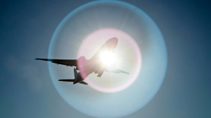 FILE - In this March 18, 2020 file photo, a Southern China Airlines flight from Guangzhou, China passes in front of the sun as it arrives at Vancouver International Airport in Richmond, British Columbia, Canada. On Wednesday, June 3, 2020, the Trump administration moved to block Chinese airlines from flying to the U.S. in an escalation of trade and travel tensions between the two countries. (Jonathan Hayward/The Canadian Press via AP)