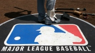 FILE - Major League Baseball rejected the players' offer for a 114-game regular season in the pandemic-delayed season with no additional salary cuts and told the union it did not plan to make a counterproposal, a person familiar with the negotiations told The Associated Press..(AP Photo/Charles Rex Arbogast, File)