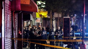 New York City police officers gather early Thursday, June 4, 2020, near the site of shooting Wednesday night in the Brooklyn borough of New York. (AP Photo/Frank Franklin II)