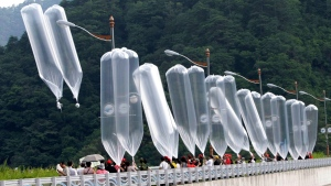 In this July 29, 2010, file photo, South Korean conservative activists launch balloons carrying leaflets denouncing North Korean leader Kim Jong Il during a rally in Hwacheon, South Korea. South Korea says it plans to push new laws to ban activists from flying anti-Pyongyang leaflets over the border after North Korea threatened to end an inter-Korean military agreement reached in 2018 to reduce tensions if Seoul fails to prevent the protests. (AP Photo/Ahn Young-joon, File)