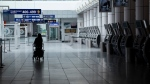 A lone passenger is seen at Montreal's Trudeau International Airport on Tuesday, June 2, 2020. THE CANADIAN PRESS/Paul Chiasson
