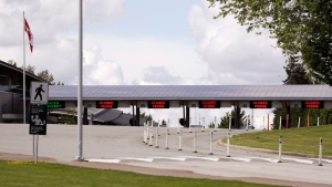 In this photo taken Sunday, May 17, 2020, a single lane remains heading into Canada from the U.S. at the Peace Arch border crossing in Blaine, Wash. (AP Photo/Elaine Thompson)