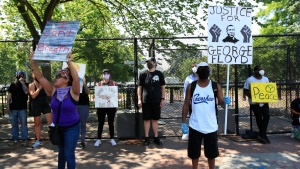 Demonstrators protest Thursday, June 4, 2020, near the White House in Washington, over the death of George Floyd, a black man who was in police custody in Minneapolis. (AP Photo/Manuel Balce Ceneta)