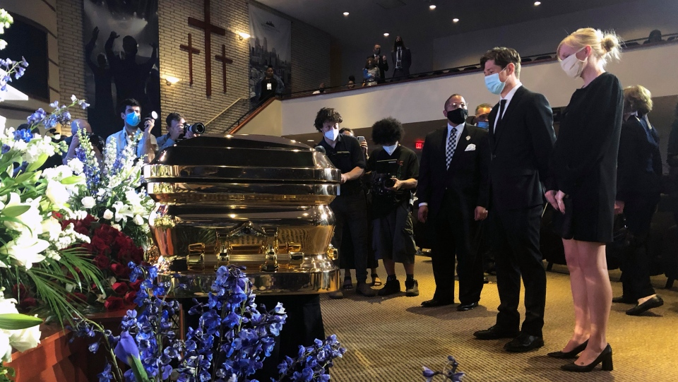 Minneapolis Mayor Jacob Frey, second from right, and First Lady Sarah Clarke, right pause before George Floyd's casket Thursday, June 4, 2020, before a memorial service for Floyd in Minneapolis. (AP Photo/Bebeto Matthews)