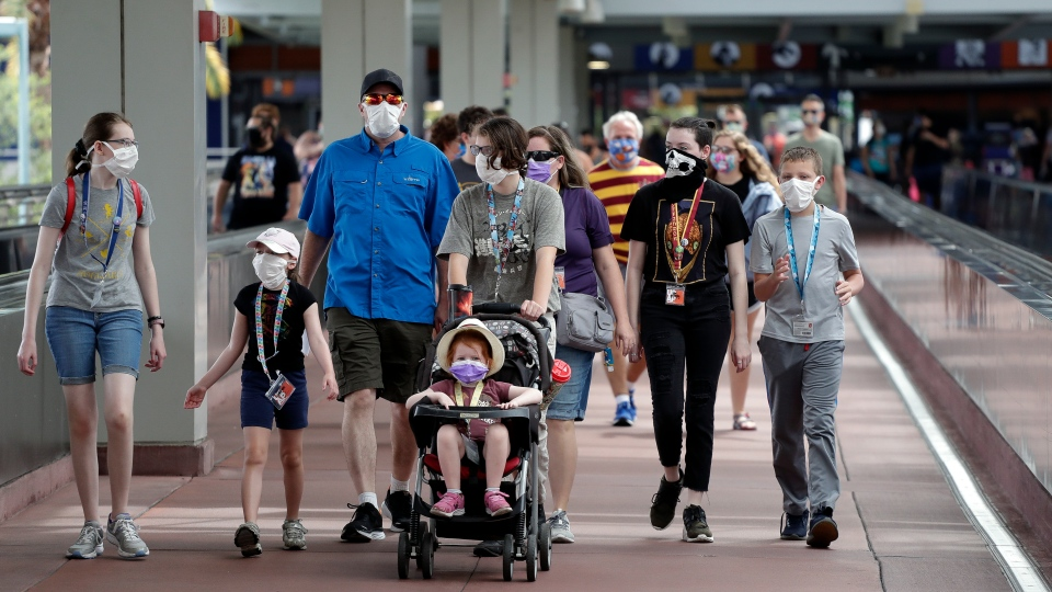 Guests arrive at Universal Orlando Resort on Wednesday, June 3, 2020, in Orlando, Fla. (AP Photo/John Raoux)