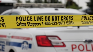 Police tape is seen in front of a Durham Regional Police cruiser. (Durham Regional Police)