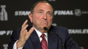 FILE - In this May 27, 2019, file photo, NHL Commissioner Gary Bettman speaks to the media before Game 1 of the NHL hockey Stanley Cup Final between the St. Louis Blues and the Boston Bruins, in Boston. The NHL nailed down the final details of a playoff format if the season can resume on the same day word came out that another player has tested positive for the coronavirus. (AP Photo/Charles Krupa, File)