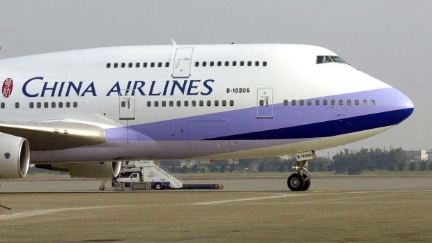 FILE - In this Jan. 26, 2003, file photo, a China Airlines Boeing 747-400 sits on the tarmac at the Chiang Kai-shek International airport in Taoyuan, Taiwan. The Trump administration on Friday, June 5, 2020, is backing away from a threat to ban all flights to the U.S. by Chinese airlines. It will allow Chinese carriers to operate a total of two flights a week between the two countries.(AP Photo/Jerome Favre, File)