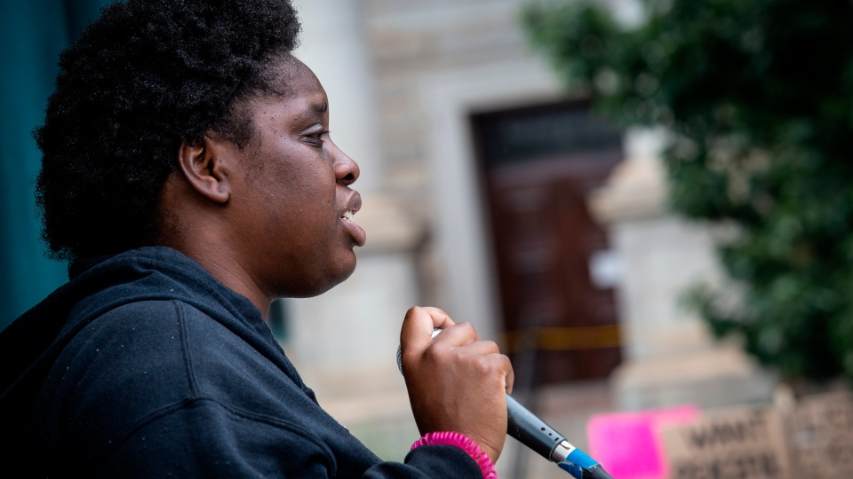 Chaleah Head, 19, a college student who helped organize a large rally and protest march, addresses the crowd Wednesday, June 3, 2020, in Decatur, Ga. The protest and rally at the town square brought out hundreds who chanted the name George Floyd and filled the streets with demands for justice. (AP Photo/Ron Harris)
