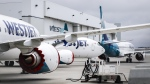 WestJet Boeing 737 Max aircraft are shown at the airline's facilities in Calgary, Alta., Tuesday, May 7, 2019. WestJet Airlines Ltd. has quietly changed its refund policy to allow some customers whose flights were cancelled due to the pandemic to reclaim their cash. THE CANADIAN PRESS/Jeff McIntosh