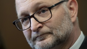 Minister of Justice and Attorney General of Canada David Lametti speaks with the media following party caucus in Ottawa, Tuesday, January 28, 2020. The federal government wants to ensure the global pandemic doesn't make someone miss a crucial deadline in a bankruptcy case, divorce proceeding or other civil matter.. THE CANADIAN PRESS/Adrian Wyld