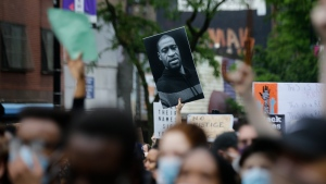 Protesters march during a solidarity rally for George Floyd, Friday, June 5, 2020, in the Brooklyn borough of New York. Floyd died after being restrained by Minneapolis police officers on May 25. (AP Photo/Frank Franklin II)