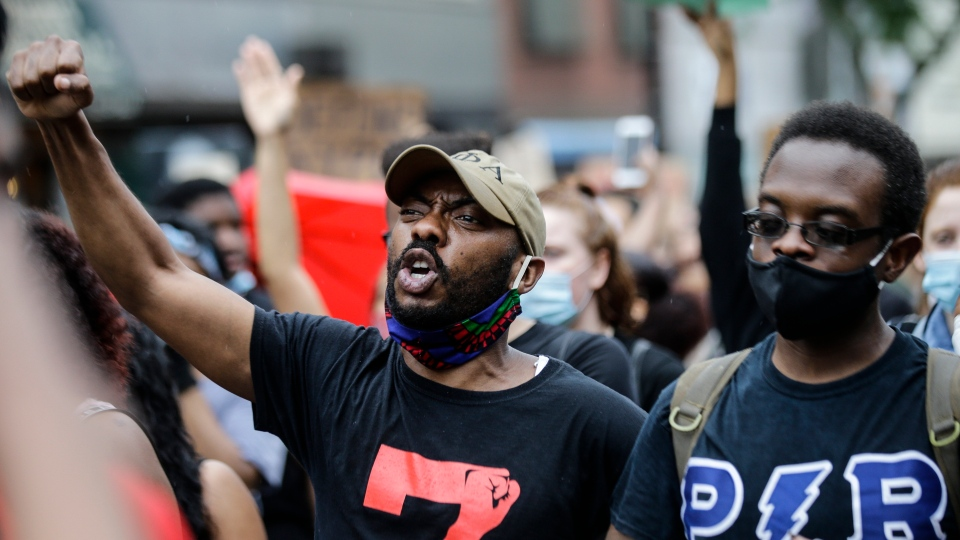 Protesters march during a solidarity rally for George Floyd, Friday, June 5, 2020, in the Brooklyn borough of New York. Floyd died after being restrained by Minneapolis police officers on May 25.(AP Photo/Frank Franklin II)